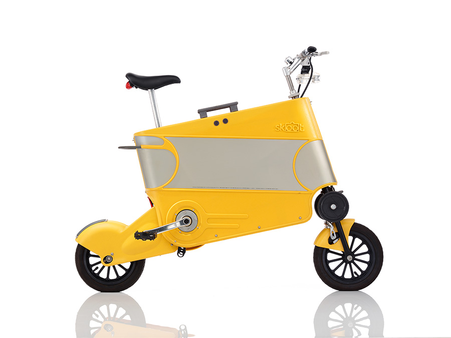 SKOOT INTERNATIONAL LTDSkoot • a suitcase-shaped bike • designed by Vincent Fallon and his son Vaughan • seat, wheels and handlebars can be pulled out of the yellow 'case' • cranks need to be attached • the Skoot can be used short distances • weighs a 14.5 kilograms (32 lb) • perfect for travels planes, buses and trains