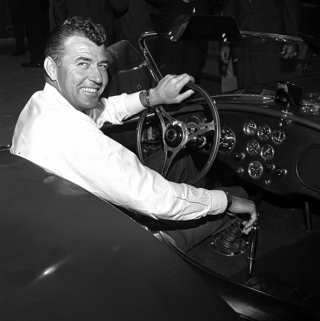 Carroll Shelby at wheel, smiling