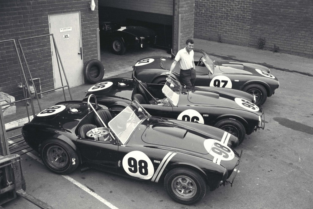 Carroll Shelby poses with three roadsters in California, 1963.