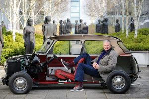 Inventor and entrepreneur Sir James Dyson at his Malmesbury offices, Wiltshire with a bisection of an original Mini - homage to his design hero Alec Issigonis. (Photo: Adrian Sherratt)