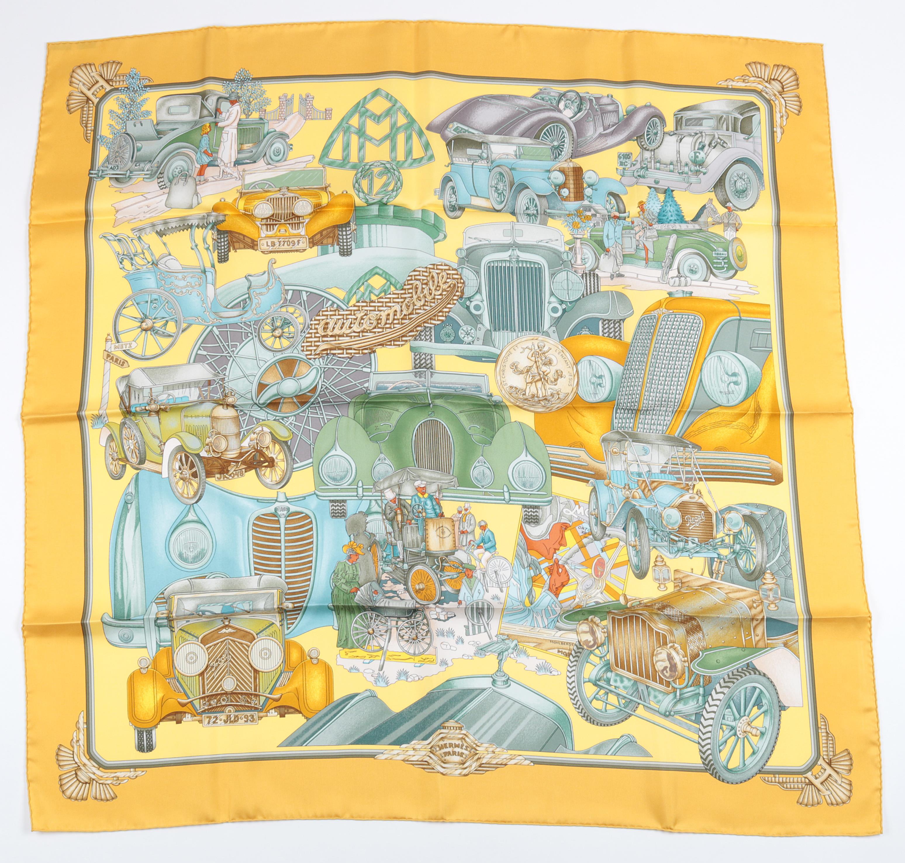 """Hermès Schultertuch """"Automobile"""", Entwurf Joachim Metz 1996, verschiedene Automobile in Blau, Grün und Gelbtönen auf gelbem Fond, rollierter Saum, ca. 89 x 89 cm, Startpreis € 180"""